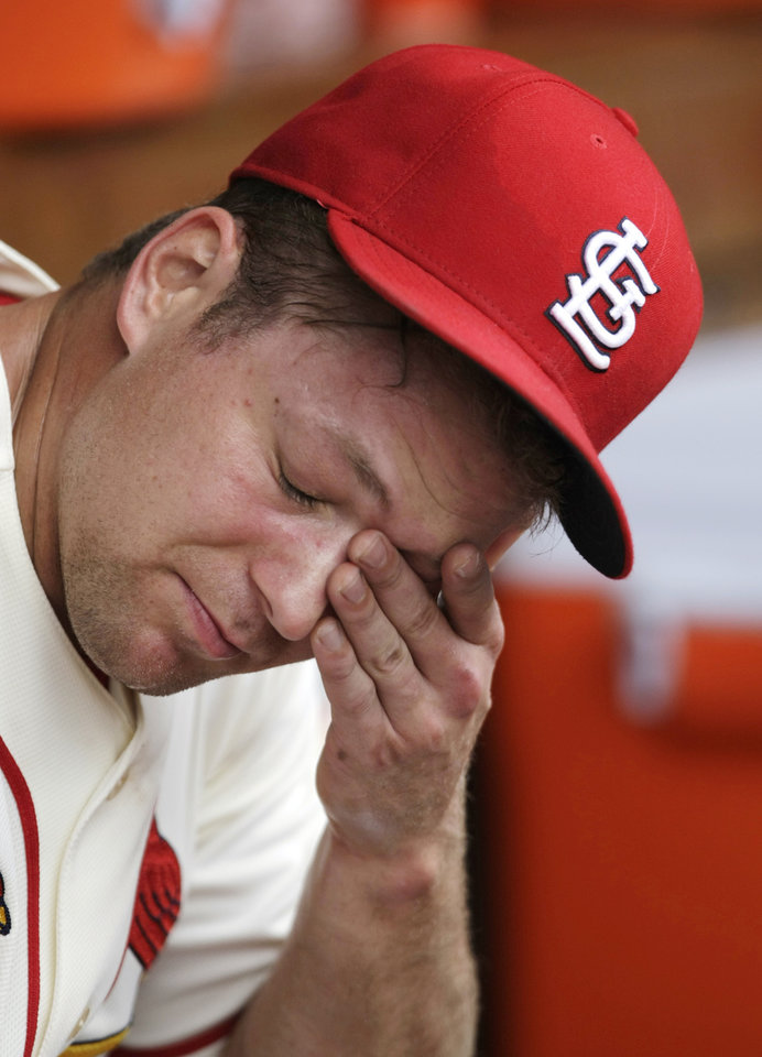 Photo - St. Louis Cardinals relief pitcher Trevor Rosenthal reacts in the dugout after being pulled in the ninth inning of a baseball game against the Miami Marlins, Saturday, July 5, 2014 in St. Louis. Rosenthal takes the loss as the Miami Marlins came from behind to beat the Cardinals, 6-5.(AP Photo/Tom Gannam)