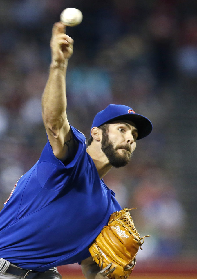 Photo - Chicago Cubs' Jake Arrieta throws a pitch against the Arizona Diamondbacks during the first inning of a baseball game on Sunday, July 20, 2014, in Phoenix. (AP Photo/Ross D. Franklin)