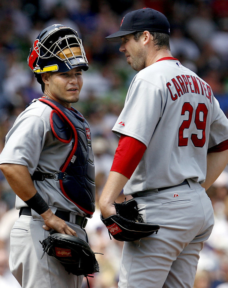 Catcher Yadier Molina, left, and pitcher Chris Carpenter are the only Cardinals left from their 2004 World Series team. AP photo
