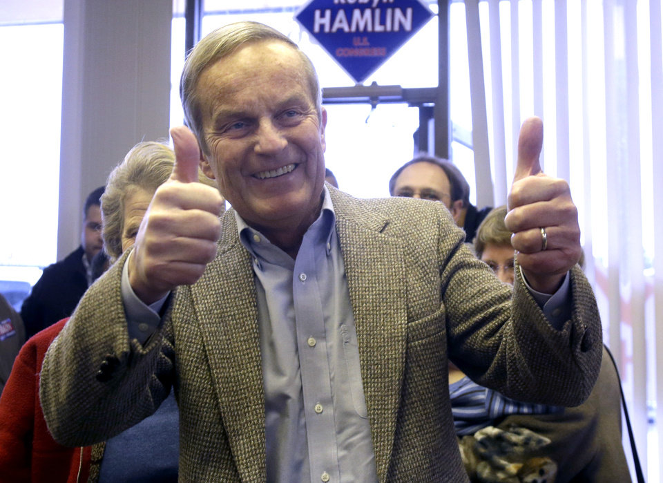 Photo -   Missouri Republican Senate candidate, Rep. Todd Akin, R-Mo., gives two thumbs up as he enters a Republican campaign office to visit with supporters Monday, Nov. 5, 2012, in Florissant, Mo. Akin is running against Democratic incumbent Sen. Claire McCaskill. (AP Photo/Jeff Roberson)