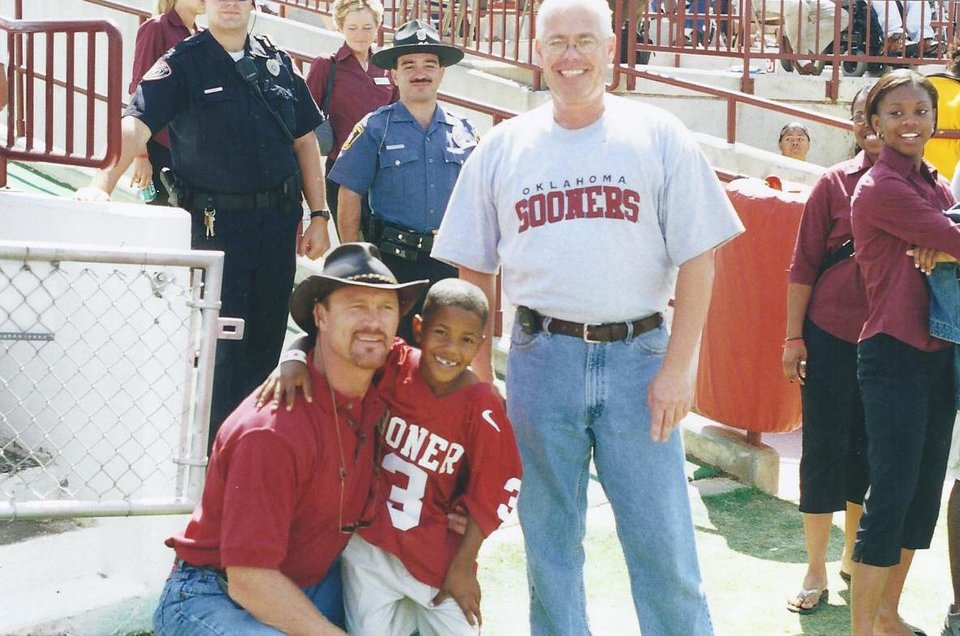 Photo - Sterling Shepard, right, with former OU standout Brian Bosworth before a Sept. 23, 2000, game against Rice during which OU's 1985 national championship team was honored. Sterling's father, Derrick Shepard, played on the 1985 team. PHOTO  PROVIDED