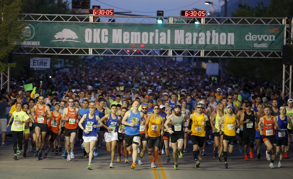 Photo - Runners begin the Oklahoma City Marathon in Oklahoma City,  Sunday, April 29, 2018. Photo by Sarah Phipps, The Oklahoman
