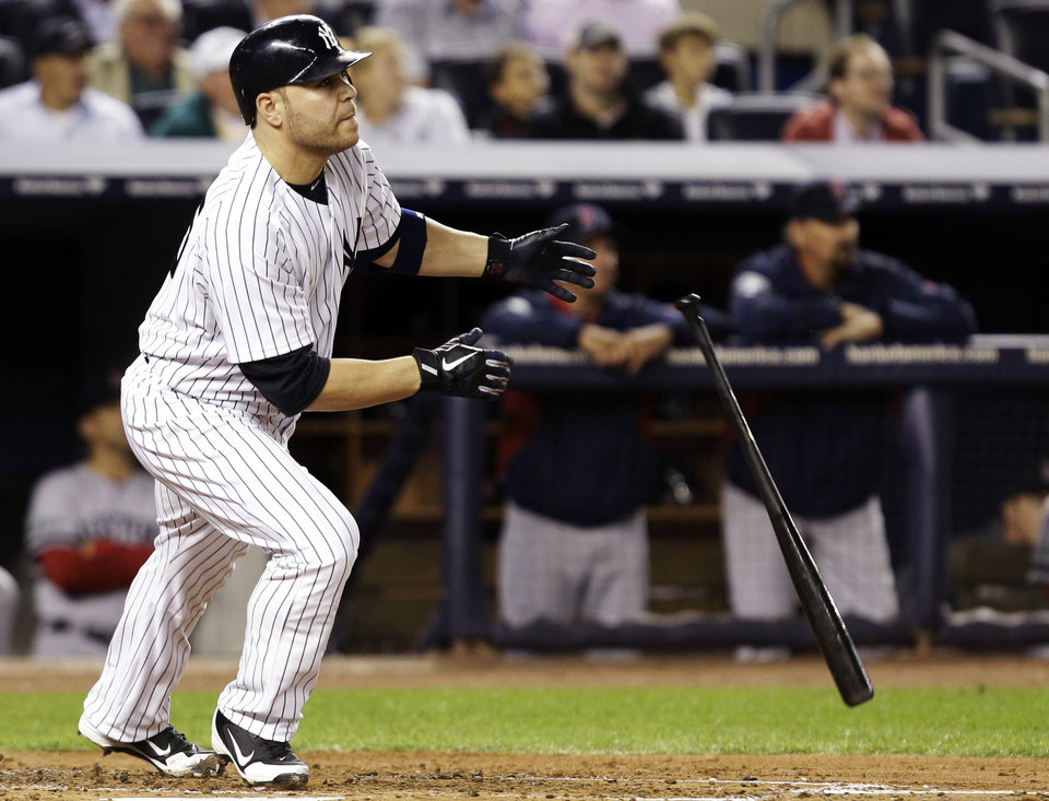 Photo -   New York Yankees' Russell Martin watches his second-inning, solo home run off Boston Red Sox starting pitcher Clay Buchholz during their baseball game at Yankee Stadium in New York, Monday, Oct. 1, 2012. (AP Photo/Kathy Willens)