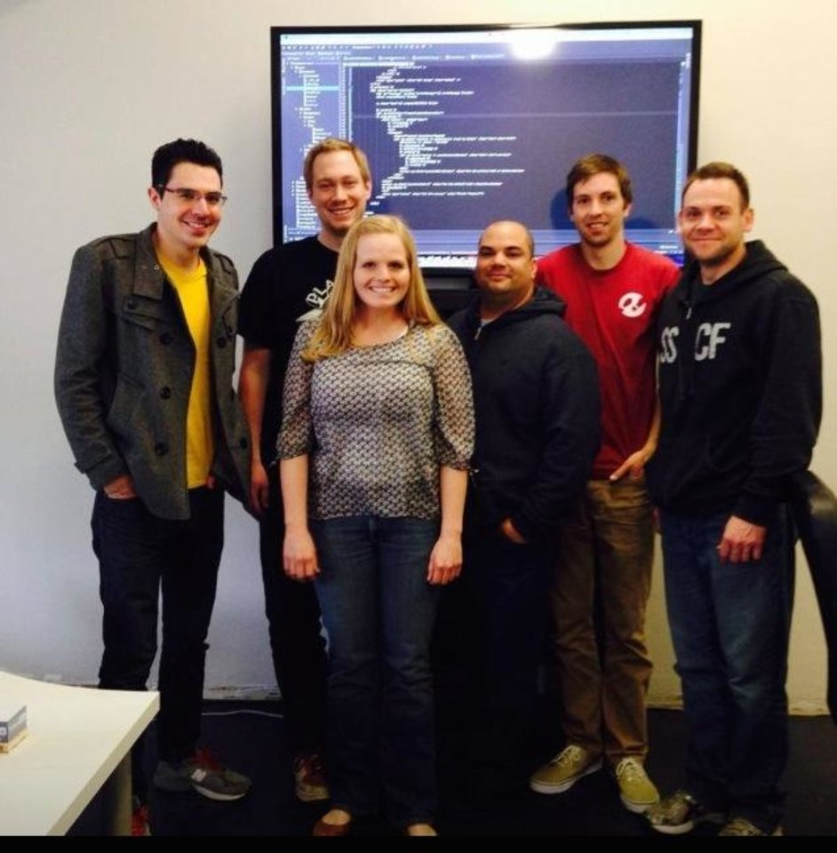 Photo -       Coding Campus instructors Chris Stevenson (far left) and Daniel Stephenson (far right) pose in a new Coding Campus classroom with alumni Joe Ipson, Breana Jones, Henry Incer, and Michael Romrell (l-r).