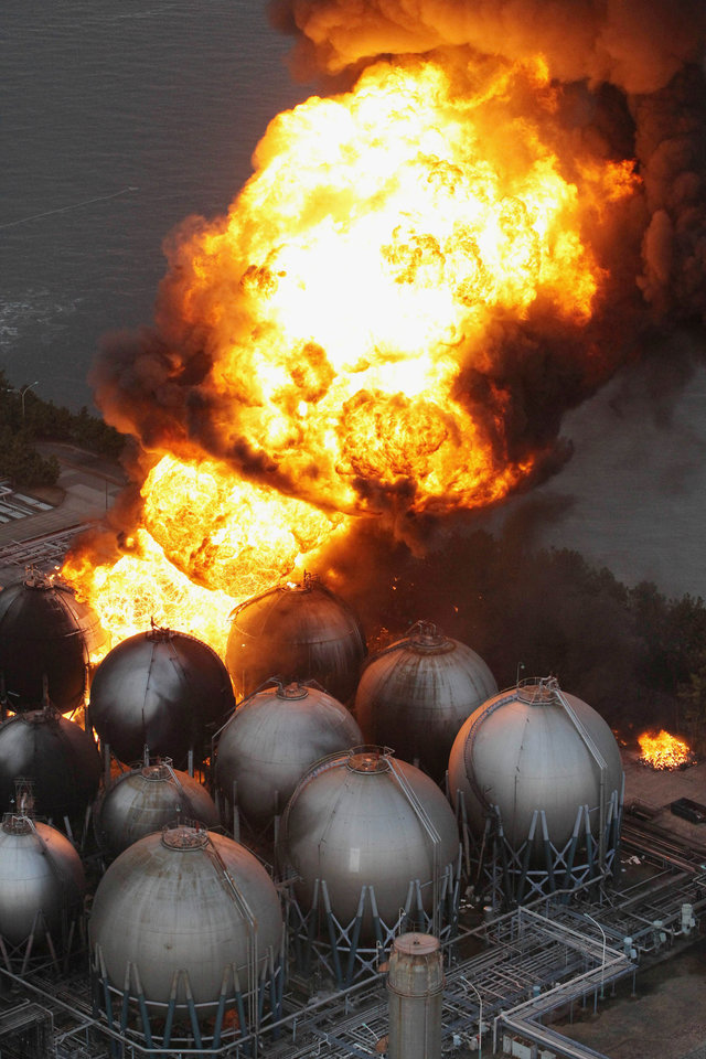 Photo - Giant fireballs rise from a burning oil refinery in Ichihara, Chiba Prefecture (state) after Japan was struck by a strong earthquake off its northeastern coast Friday, March 11, 2011. (AP Photo/Kyodo News) JAPAN OUT, MANDATORY CREDIT, FOR COMMERCIAL USE ONLY IN NORTH AMERICA ORG XMIT: TOK818