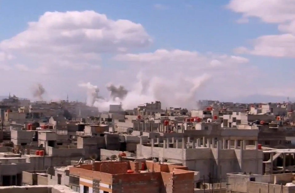 In this image taken from video obtained from the Shaam News Network, which has been authenticated based on its contents and other AP reporting, columns of smoke rise from heavy bombing by Syrian government forces in Arbeen, Syria, Monday March 18, 2013. Two years after the anti-Assad uprising began, the conflict has become a civil war, with hundreds of rebel group fighting Assad\'s forces across Syria and millions of people pushed from their homes by the violence. The U.N. says more than 70,000 people have been killed. (AP Photo/Shaam News Network via AP video)
