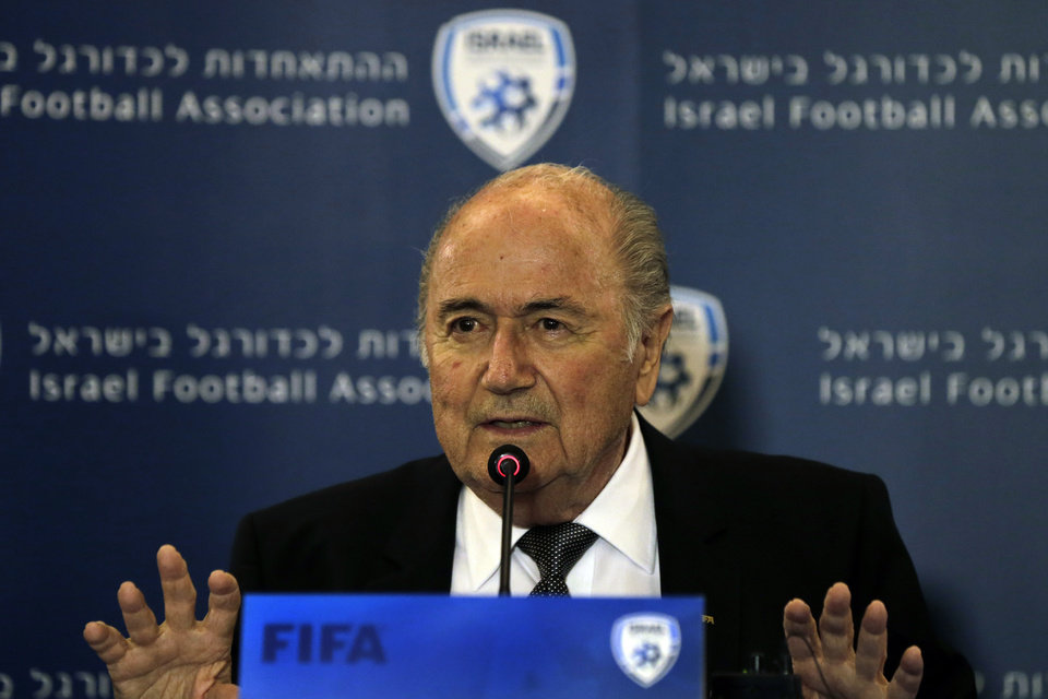 Photo - FIFA President Sepp Blatter speaks during a news conference in Jerusalem, Tuesday, May 27, 2014. Blatter said that he hopes to resolve a dispute between Israel and the Palestinians before the World Cup begins. The Palestinian Football Association has complained to Blatter about Israeli travel restrictions on some of their players in the West Bank as well as in the Gaza Strip. Israel has imposed some travel restrictions on Palestinians in those areas citing concerns about possible suicide bombings and other attacks by Palestinian militants. Critics say those restrictions can amount to collective punishment. (AP Photo/Tsafrir Abayov)