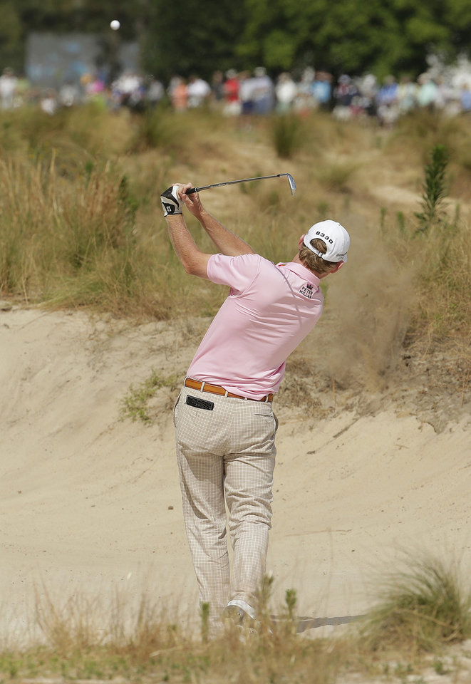 Photo - Brandt Snedeker hits out of the bunker on the 11th hole during the first round of the U.S. Open golf tournament in Pinehurst, N.C., Thursday, June 12, 2014. (AP Photo/Charlie Riedel)