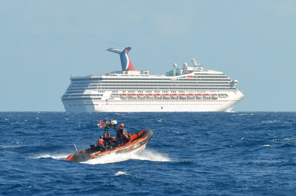 In this image released by the U.S. Coast Guard on Feb. 11, 2013, a small boat belonging to the Coast Guard Cutter Vigorous patrols near the cruise ship Carnival Triumph in the Gulf of Mexico, Feb. 11, 2013. The Carnival Triumph has been floating aimlessly about 150 miles off the Yucatan Peninsula since a fire erupted in the aft engine room early Sunday, knocking out the ship\'s propulsion system. No one was injured and the fire was extinguished. (AP Photo/U.S. Coast Guard- Lt. Cmdr. Paul McConnell)