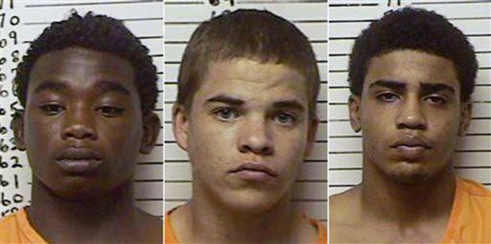 Photo - Accused in the death of Christopher Lane are, from left, James Francis  Edwards Jr., Michael Dewayne  Jones  and Chancey Allen Luna, all of Duncan. AP PHOTO  Uncredited - AP