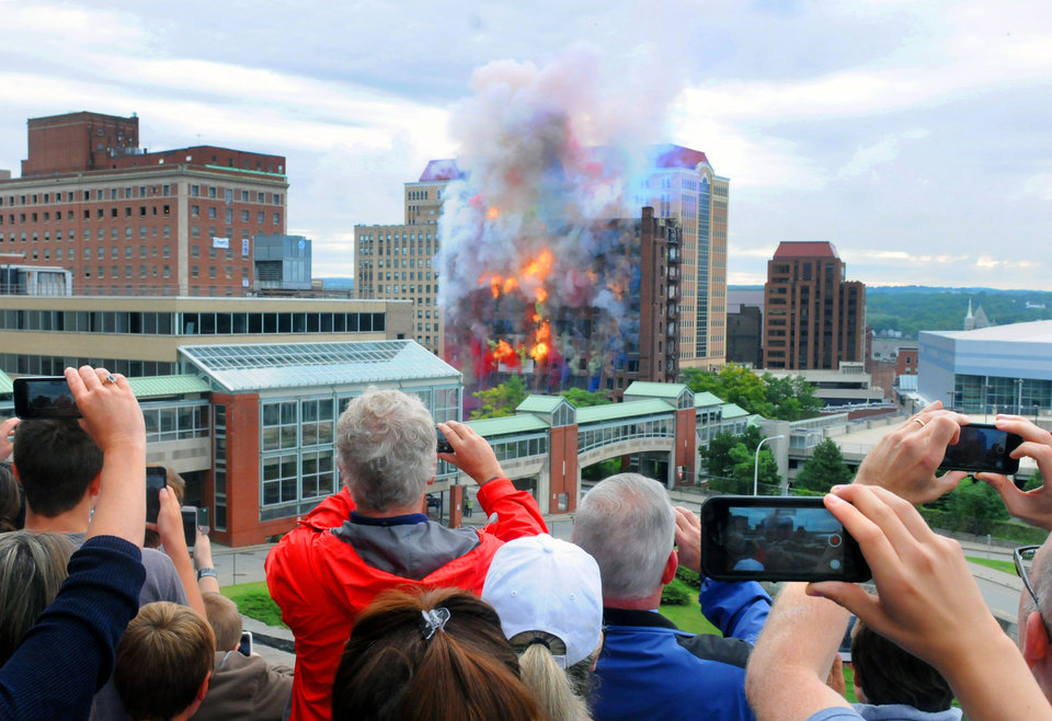 Photo - Spectators watch from the Empire State Plaza, below the Egg, as the Wellington Annex is imploded to make way for the new Capital Center on Saturday Aug. 23, 2014 in Albany, N.Y. (AP Photo/Times Union, Michael P. Farrell)