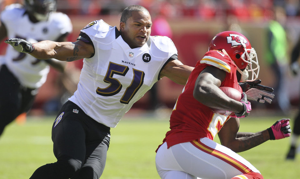 Baltimore Ravens linebacker Brendon Ayanbadejo (51) tackles Kansas City Chiefs defensive back Javier Arenas (21) during the first half of an NFL football game at Arrowhead Stadium in Kansas City, Mo., Sunday, Oct. 7, 2012. (AP Photo/Colin E. Braley)