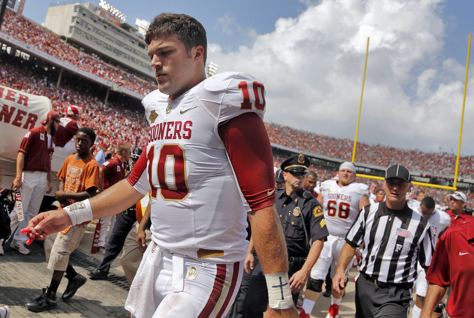 Photo -  OU's Blake Bell (10) walks off the field at halftime during the Red River Rivalry college football game between the University of Oklahoma Sooners (OU) and the University of Texas Longhorns (UT) at the Cotton Bowl Stadium in Dallas, Saturday, Oct. 12, 2013. Photo by Chris Landsberger, The Oklahoman