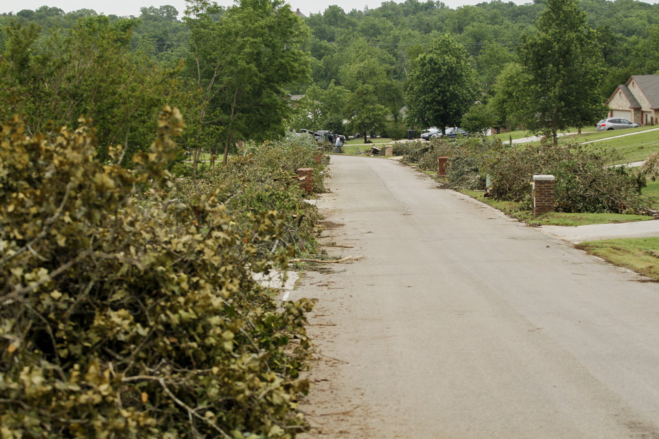 Piles of cut up trees line the streets in the Dripping Springs Estates Saturday, May 15, 2010. Saturday hundreds of volunteers went into areas that had been affected by last week\'s tornadoes to help clear debris. Photo by Doug Hoke, The Oklahoman.