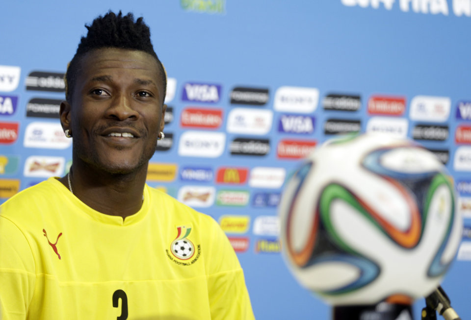 Photo - Ghana's Asamoah Gyan attends a news conference before an official training session the day before the group G World Cup soccer match between Ghana and the United States at the Arena das Dunas in Natal, Brazil, Sunday, June 15, 2014.  (AP Photo/Dolores Ochoa)