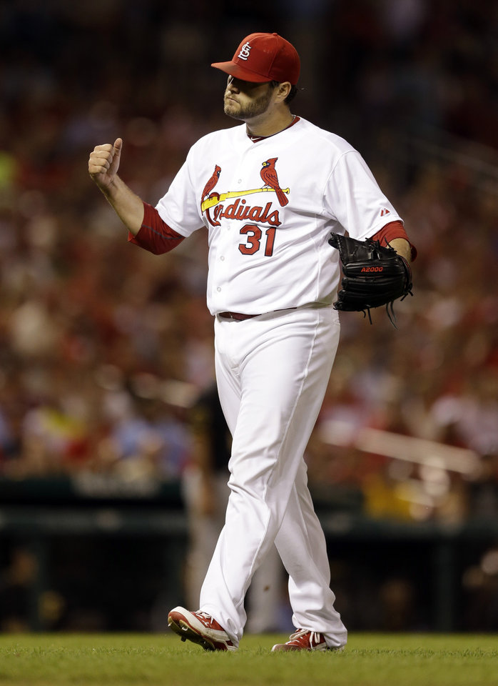 Photo - St. Louis Cardinals starting pitcher Lance Lynn celebrates after getting Pittsburgh Pirates' Andrew McCutchen to ground out to end the top of the fifth inning of a baseball game Wednesday, July 9, 2014, in St. Louis. (AP Photo/Jeff Roberson)