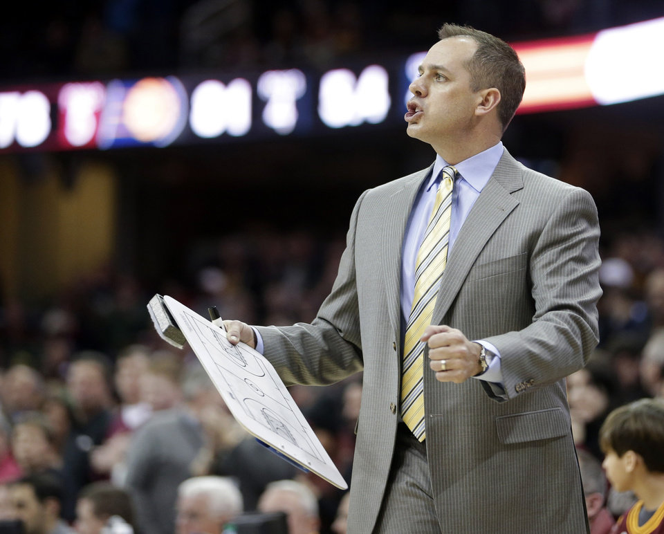 Photo - Indiana Pacers head coach Frank Vogel reacts in the fourth quarter of an NBA basketball game against the Cleveland Cavaliers, Sunday, Jan. 5, 2014, in Cleveland. The Pacers won 82-78. (AP Photo/Tony Dejak)