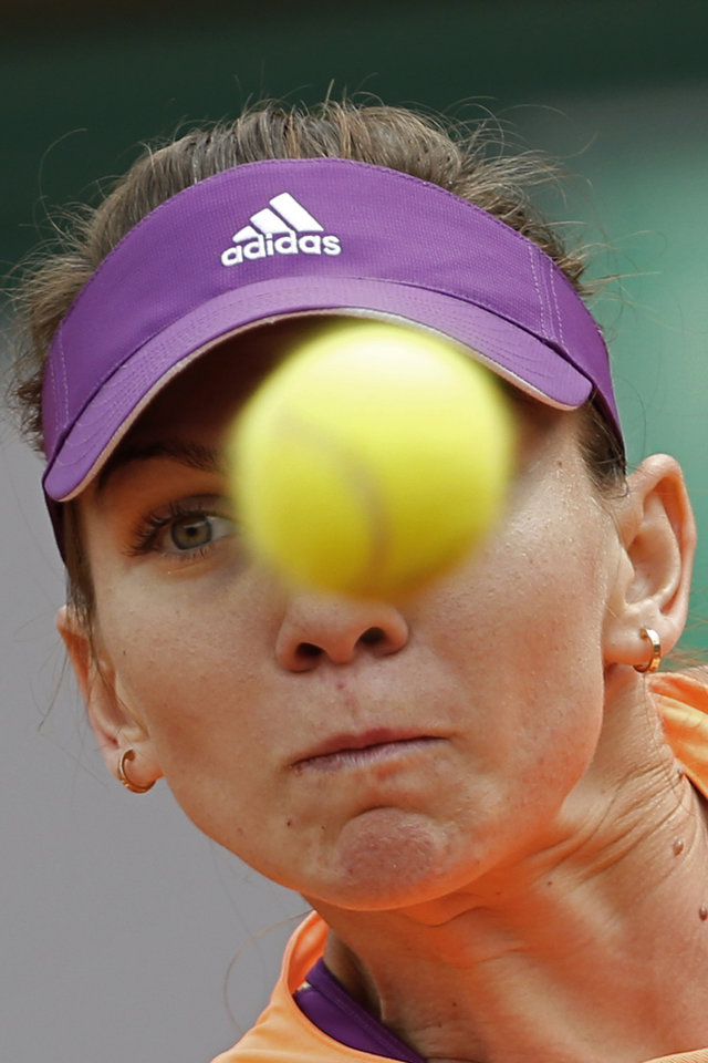 Photo - Romania's Simona Halep returns the ball during the fourth round match of the French Open tennis tournament against Sloane Stephens of the U.S.  at the Roland Garros stadium, in Paris, France, Monday, June 2, 2014. (AP Photo/Darko Vojinovic)