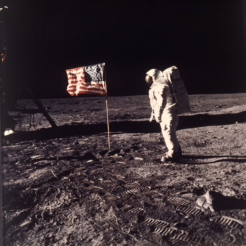 "FILE - This July 20, 1969 file photo released by NASA shows astronaut Edwin E. ""Buzz"" Aldrin Jr.  posing for a photograph beside the U.S. flag deployed on the moon during the Apollo 11 mission.  Aldrin and fellow astronaut Neil Armstrong were the first men to walk on the lunar surface. Sony Electronics and the Nielsen television research company collaborated on a survey ranking TV's most memorable moments. Other TV events include, the Sept. 11 attacks in 2001, Hurricane Katrina in 2005, the O.J. Simpson murder trial verdict in 1995 and the death of Osama bin Laden in 2011. (AP Photo/NASA/Neil A. Armstrong, file) ORG XMIT: NYET134"