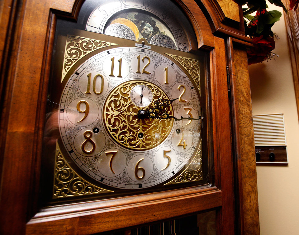 Photo - The hands on the grandfather clock standing in a corner of the formal living room of the Reneau home are frozen at 2:15, when homeowner Mary Reneau said  an earthquake shook her house hard enough to cause the clock to stop working in the early morning hours of Saturday, Nov. 5. , 2011.   Mary and her husband, Joseph were awakened around 2:15 a.m. when their house shook and items began falling off the walls and form shelves and cabinets inside their two-story brick ranch-style  home in rural Lincoln County, about  six miles northwest of Prague.  Austin Holland, a seismologist with the Oklahoma Geological Survey, placed the quake's epicenter within two to three miles of the Reneau home.  The Reneaus have lived in their house for 25 years. Photo by Jim Beckel, The Oklahoman  ORG XMIT: KOD