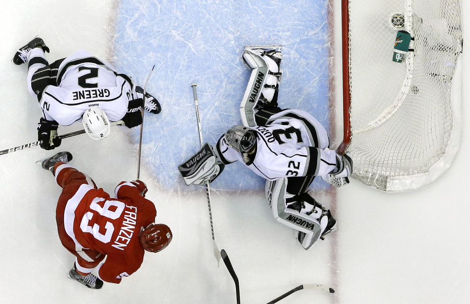 Detroit Red Wings left wing Johan Franzen (93), of Sweden, shoots the puck past Los Angeles Kings goalie Jonathan Quick (32) for a goal during a power play in the third period of an NHL hockey game in Detroit, Wednesday, April 24, 2013. (AP Photo/Carlos Osorio)