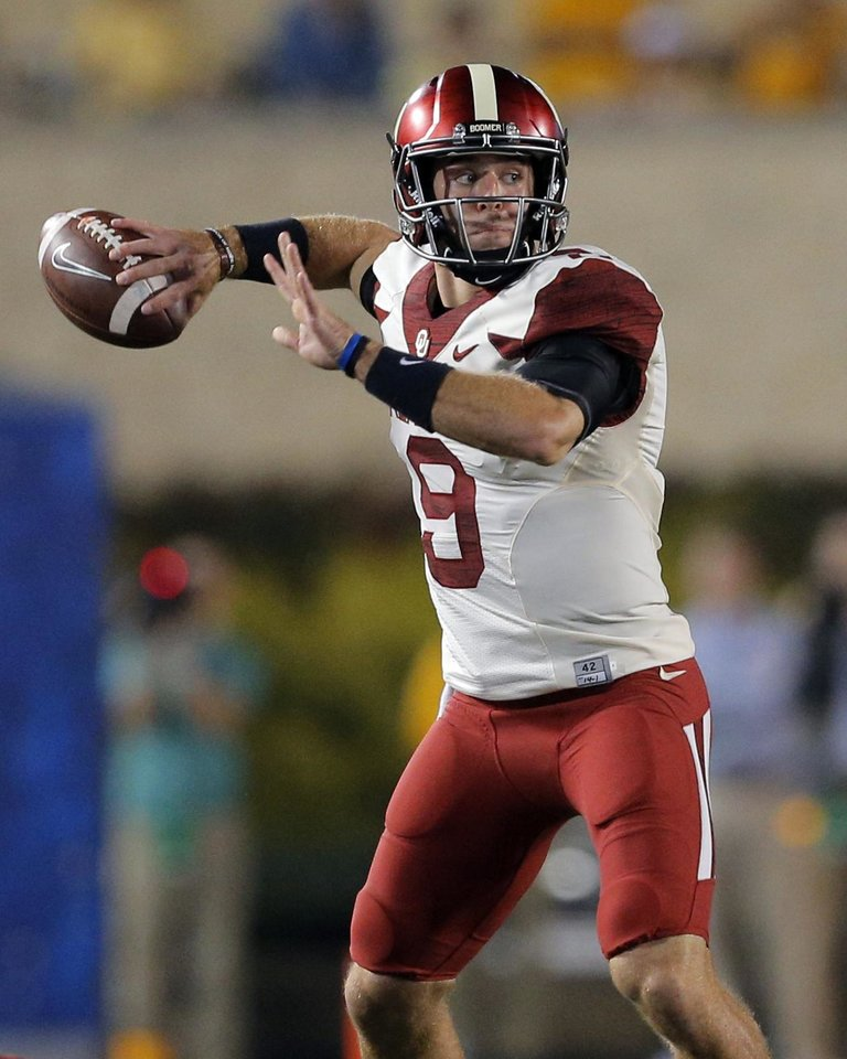 Photo - Oklahoma's Trevor Knight (9) looks to throw a pass during the college football game between West Virginia  Mountaineers and the University of Oklahoma Sooners at Milan Puskar Stadium in Morgantown, W.Va., Saturday, Sept. 20, 2014. Photo by Sarah Phipps, The Oklahoman
