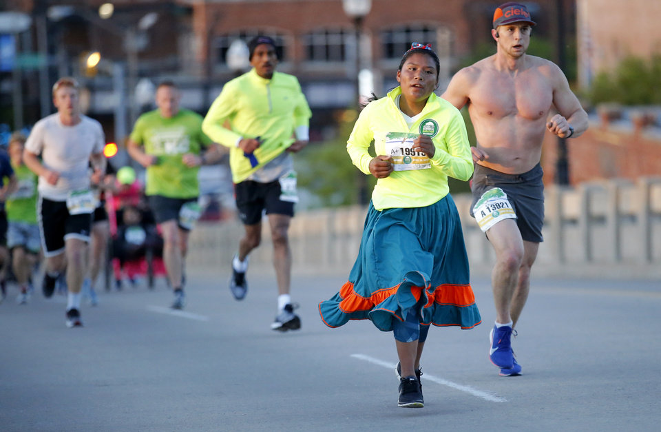 Photo - Maria Juana Ramirez Hernandez runs up Walnut Street during Oklahoma City Memorial Marathon in Oklahoma City, Sunday, April 28, 2019. [Sarah Phipps/The Oklahoman]