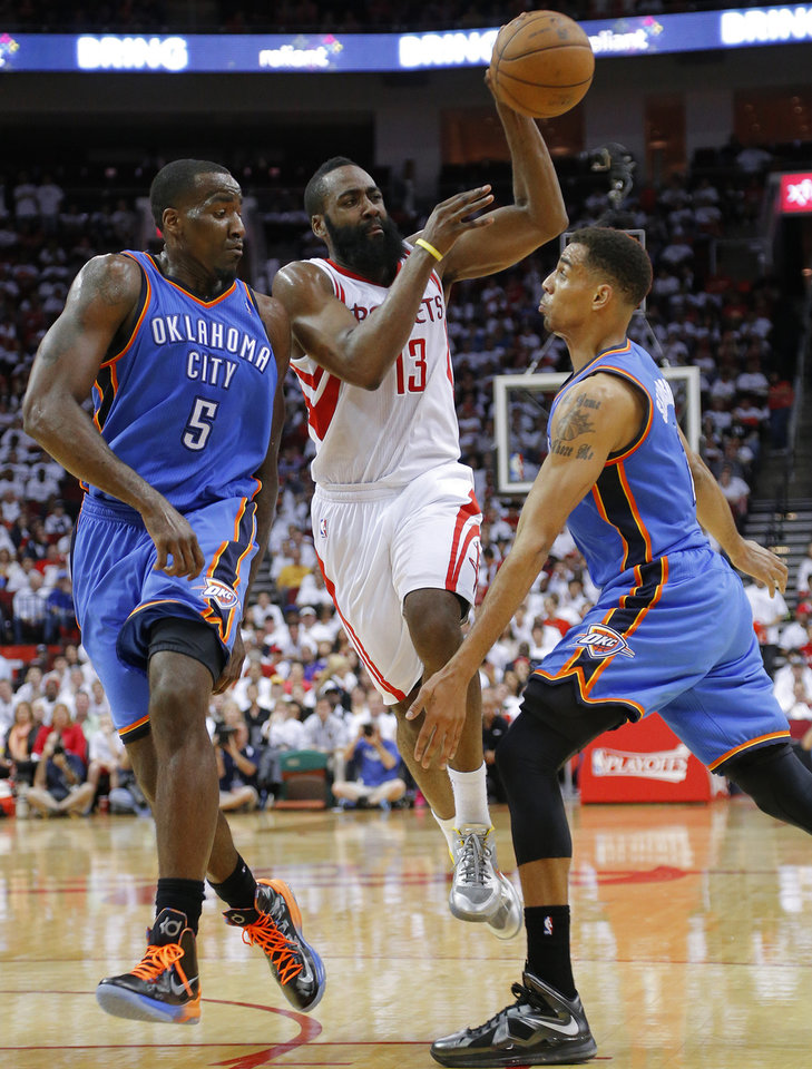 Houston's James Harden (13) passes the ball as he goes between Oklahoma City's Kendrick Perkins (5) and Thabo Sefolosha (2) during Game 3 in the first round of the NBA playoffs between the Oklahoma City Thunder and the Houston Rockets at the Toyota Center in Houston, Texas, Sat., April 27, 2013. Oklahoma City 104-101. Photo by Bryan Terry, The Oklahoman