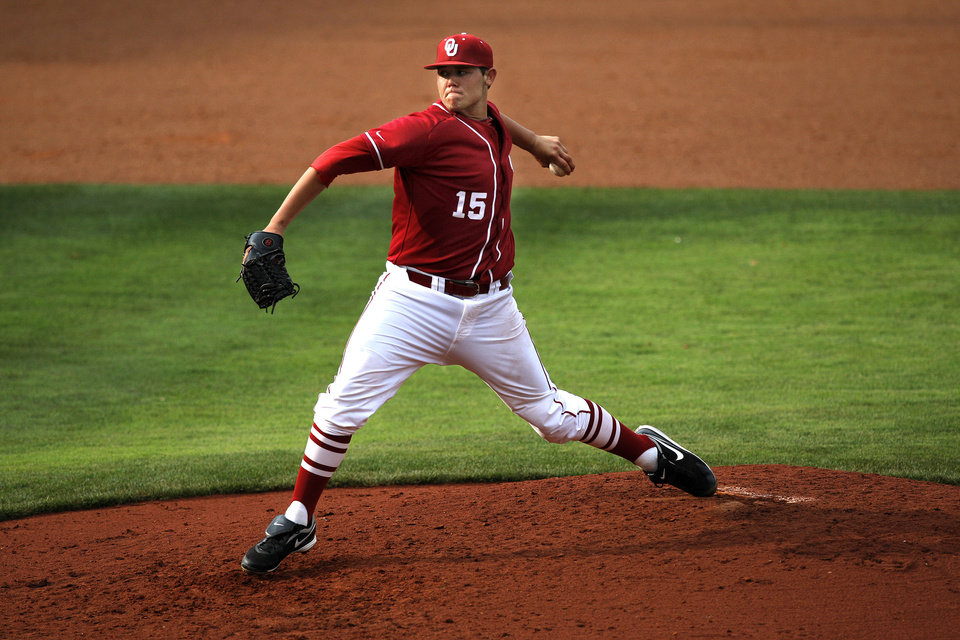 Photo - Oklahoma's Steven Okert throws a pitch during the Bedlam baseball game between the University of Oklahoma and Oklahoma State University at the Chickasaw Bricktown Ballpark in Oklahoma City, Sunday, May 6, 2012. Photo by Sarah Phipps, The Oklahoman