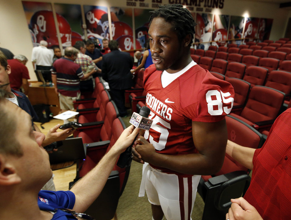 Defensive end Geno Grissom talks with the media during media access day for the University of Oklahoma Sooner (OU) football team in the Adrian Peterson meeting room in Gaylord Family-Oklahoma Memorial Stadium in Norman, Okla., on Saturday, Aug. 3, 2013. Photo by Steve Sisney, The Oklahoman