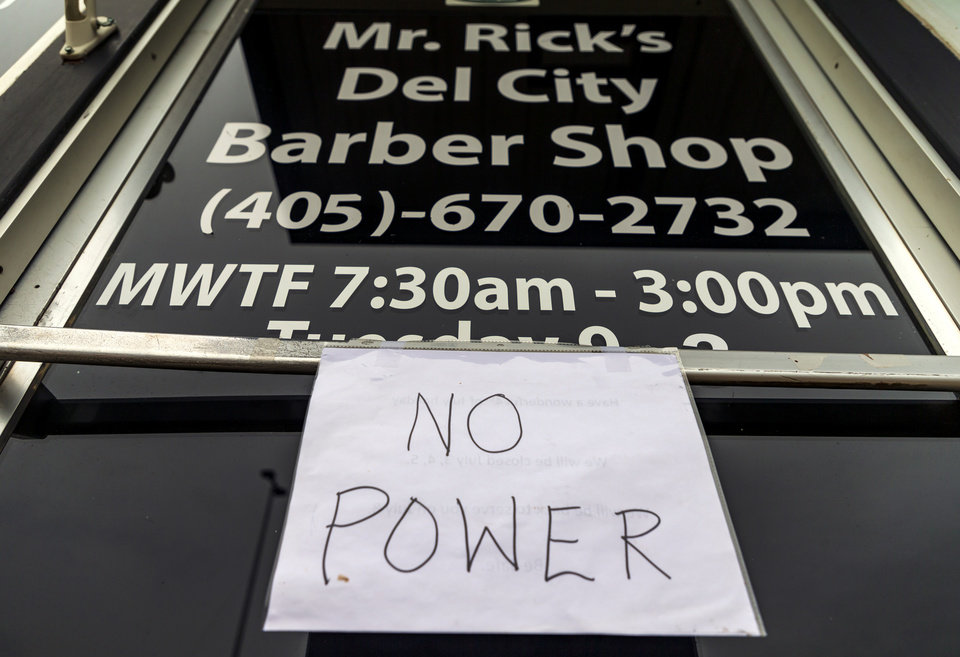 Photo - The barber shop located off of SE 15th and Sunnylane closed due to the power being knocked out by storms in Del City, Okla. on Tuesday, Aug. 27, 2019.   [Chris Landsberger/The Oklahoman]
