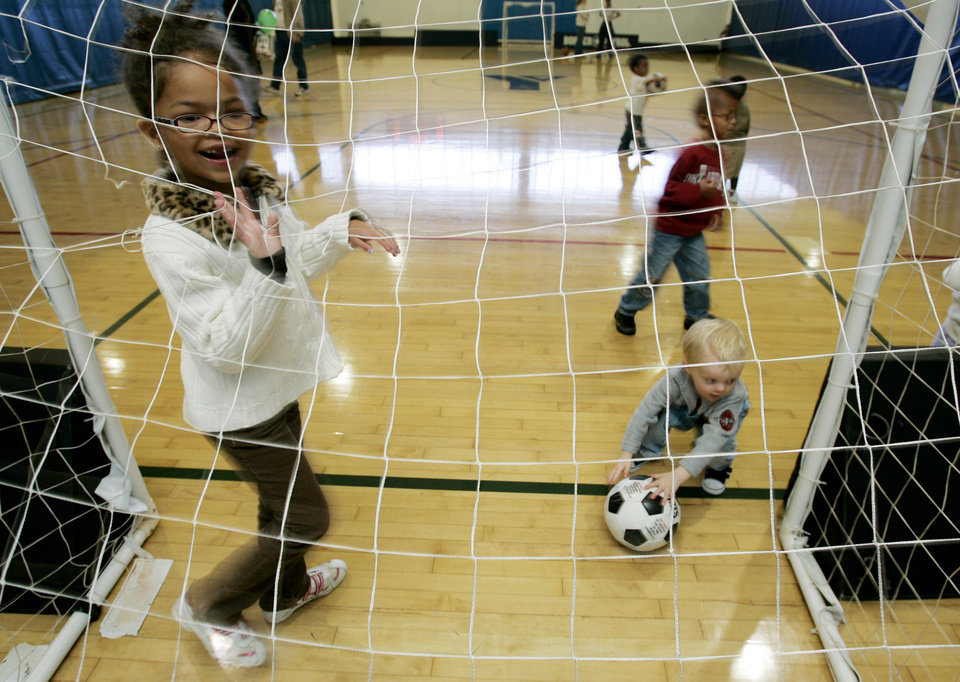 Chloe Brown ,7, of Moore tries out as a goalie during children's activities at the Cleveland County YMCA Saturday, April 12, 2008 as part of the Healthy Kids Day in Norman,OK. BY JACONNA AGUIRRE/THE OKLAHOMAN.
