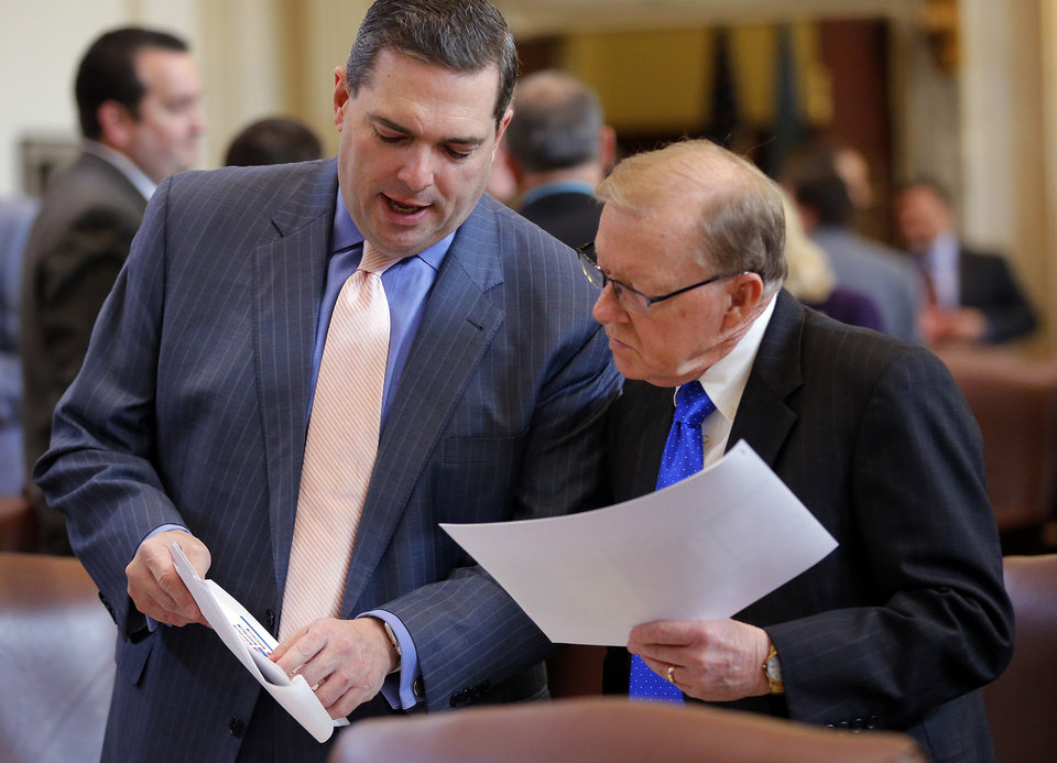 Photo - Sen. Clark Jolley, chairman of the appropriations, left, and Rep. Earl Sears, chairman of House and appropriations and budget committee talk during the Oklahoma Legislature's 2016 State-of-the-State Address by Gov. Mary Fallin in the chamber of the House of Representatives at the Oklahoma state capitol on Monday, Feb. 1, 2016, in Oklahoma City, Okla. Photo by Jim Beckel, The Oklahoman