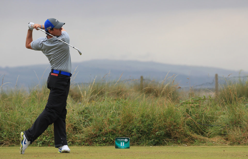 Photo - Rory McIlroy of Northern Ireland plays a shot off the 11th tee during the third day of the British Open Golf championship at the Royal Liverpool golf club, Hoylake, England, Saturday July 19, 2014. (AP Photo/Jon Super)