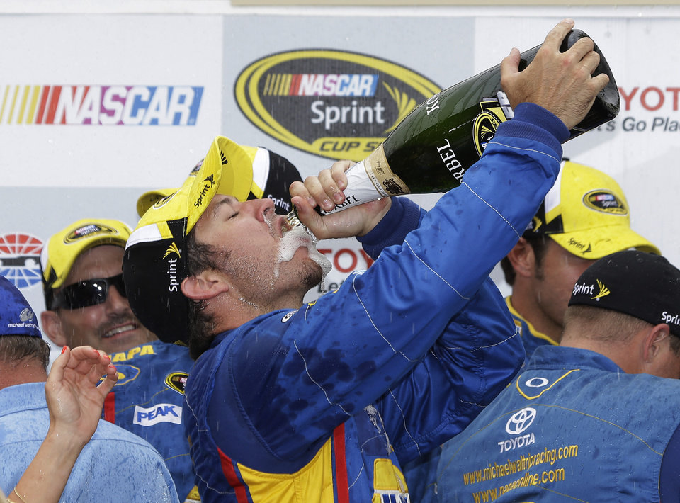 Martin Truex Jr. celebrates after winning the NASCAR Sprint Cup series auto race on Sunday, June 23, 2013, in Sonoma, Calif. (AP Photo/Eric Risberg)