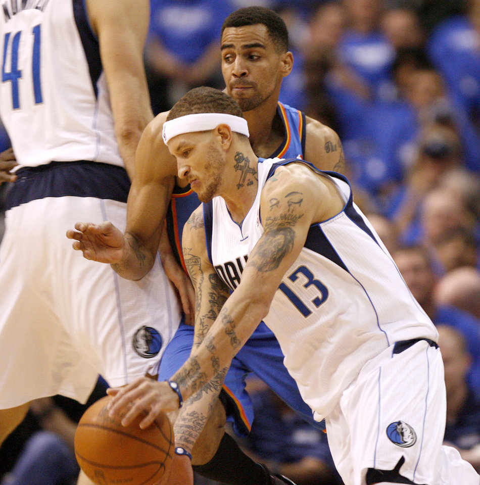 Oklahoma City's Thabo Sefolosha (2) defends Dallas' Delonte West (13) during Game 3 of the first round in the NBA playoffs between the Oklahoma City Thunder and the Dallas Mavericks at American Airlines Center in Dallas, Thursday, May 3, 2012. Photo by Bryan Terry, The Oklahoman