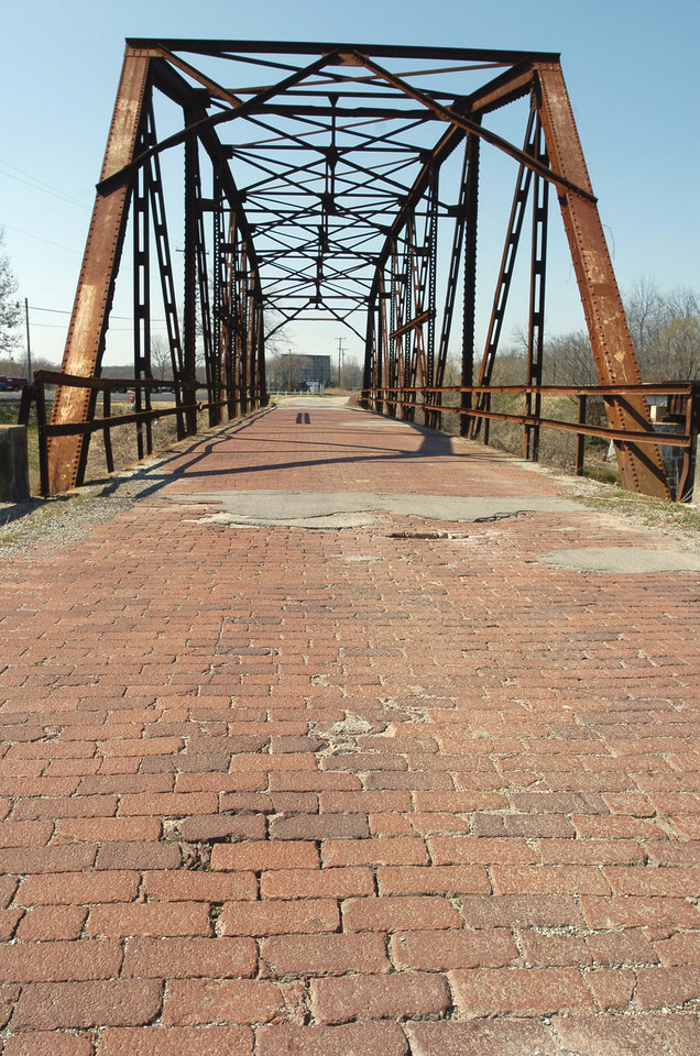 Route 66 Roadbed west of Sapulpa. Brick bridge on the east end of the section.  Sapulpa, Oklahoma, Thursday, 3/18/04.  Staff photo by David McDaniel.