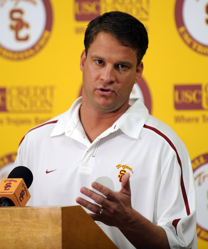 Photo - USC: University of Southern California college football coach Lane Kiffin speaks about national signing day, Wednesday, Feb. 3, 2010, in Los Angeles. (AP Photo/Mark J. Terrill) ORG XMIT: CAMT102