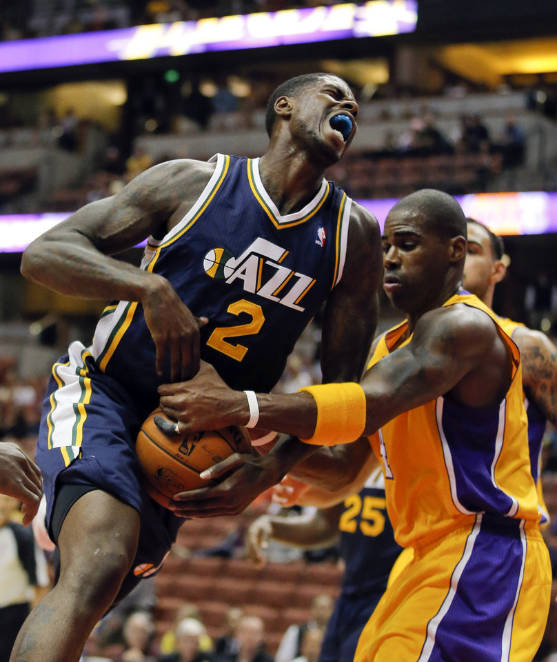 Photo -   Utah Jazz's Marvin Williams, left, is fouled by Los Angeles Lakers' Antawn Jamison during the first half of an NBA preseason basketball game in Anaheim, Calif., Tuesday, Oct. 16, 2012. (AP Photo/Jae Hong)