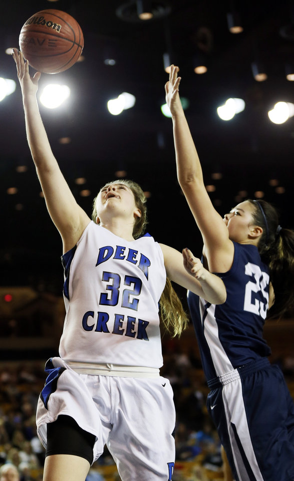 Deer Creek's Bayli Blanchard (32) shoots in front of Shawnee's Micaela Yu (25) during the Class 5A girls championship high school basketball game in the state tournament at the Mabee Center in Tulsa, Okla., Saturday, March 9, 2013. Photo by Nate Billings, The Oklahoman