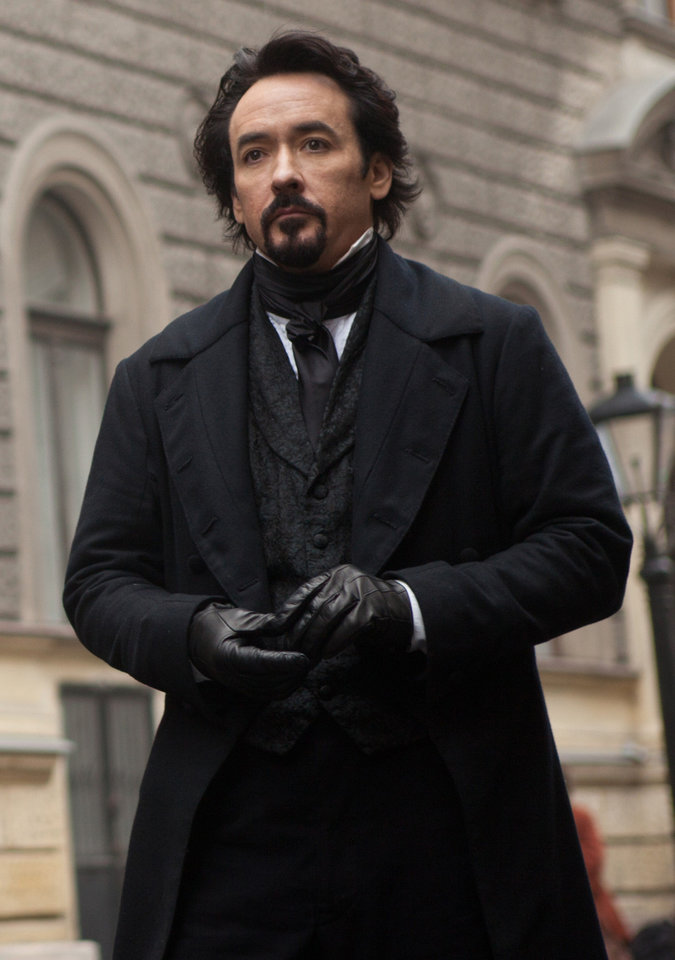 Photo - John Cusack portrays Edgar Allan Poe in a scene from the gothic thriller