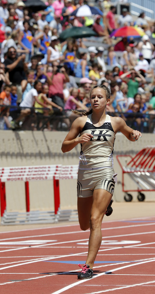 Photo - Andrea Hamric of Henryetta wins the girls 400 meter dash during the Class 3A-4A state track meet at Moore Stadium on Saturday, May 10, 2014 in Moore, Okla.  Photo by Steve Sisney, The Oklahoman