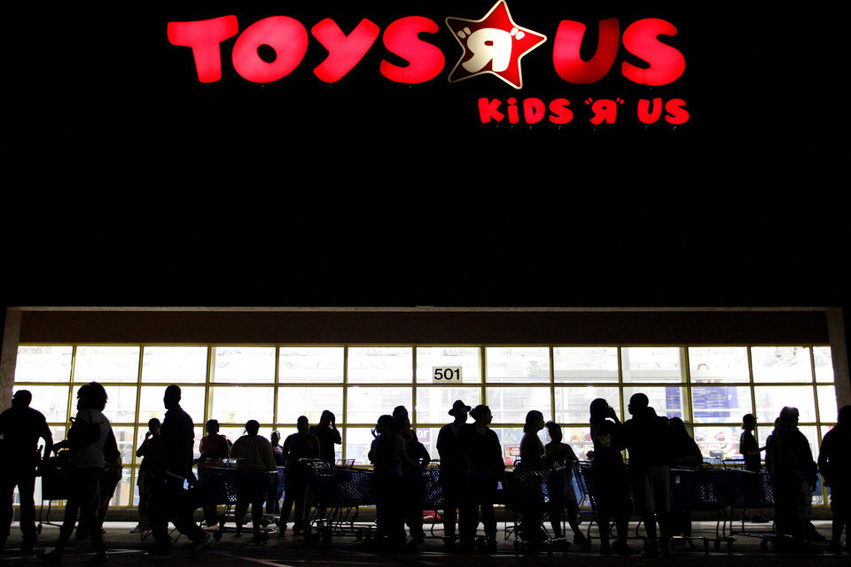Photo -   FILE - In this Thursday, Nov. 25, 2010, file photo, people line up outside Toys R Us as Black Friday sales begin o, in Royal Palm Beach, Fla. If the economic downturn has taught retailers anything, it's that a 50 percent off sale isn't enough to lure finicky American shoppers into stores these days, so this holiday season, shoppers will find that retailers are doing all kinds of things to make it easier for them to part with their money. (AP Photo/The Palm Beach Post, Rachel Mummey) MAGS OUT; TV OUT; NO SALES