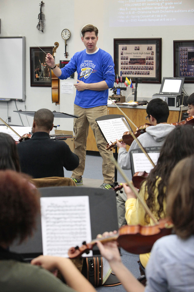 Edmond teacher of the year Peter Markes leads his Edmond North High School Orchestra students. Photo By David McDaniel, The Oklahoman <strong>David McDaniel - The Oklahoman</strong>