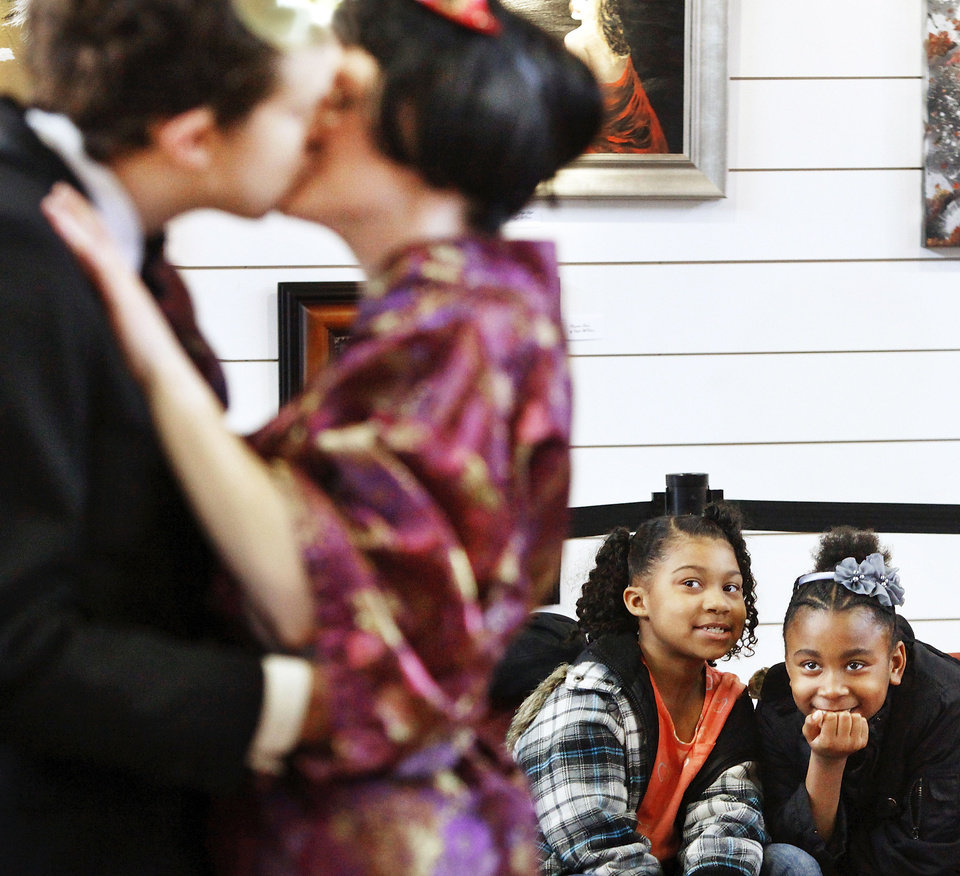 "Photo - India Irish, left, and Romiah Dorris focus on two actors kissing in this scene from ""Much Ado About Nothing."""
