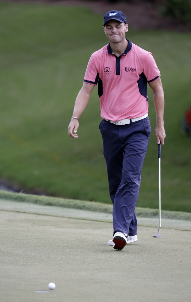 Photo - Martin Kaymer of Germany, reacts after missing a birdie putt not the 12th hole during the final round of The Players championship golf tournament at TPC Sawgrass, Sunday, May 11, 2014 in Ponte Vedra Beach, Fla. (AP Photo/John Raoux)