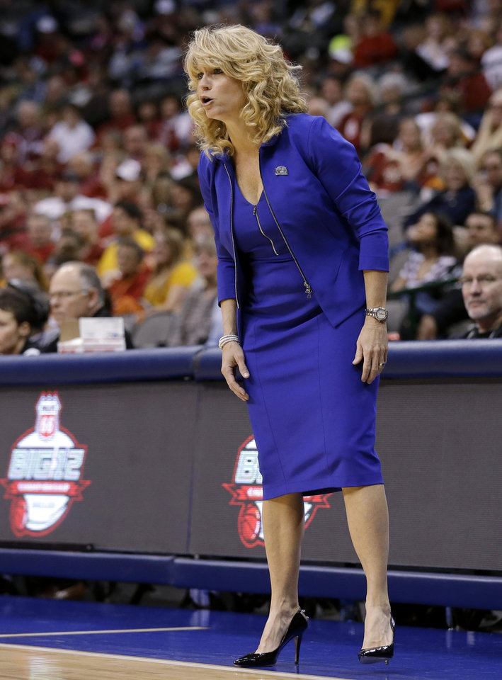 Photo - Oklahoma coach Sherri Coale talks to her players during the first half of an NCAA college basketball game against West Virginia in the Big 12 women's tournament Saturday, March 9, 2013, in Dallas. (AP Photo/Tony Gutierrez)