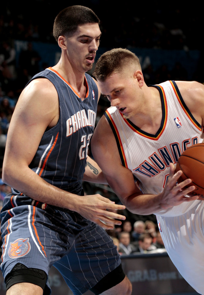 Charlotte Bobcats' Byron Mullens (22) guards Oklahoma City Thunder's Cole Aldrich (45) during the second half of the NBA basketball game as the Oklahoma City Thunder defeat the Charlotte Bobcats at 122-95 at the Chesapeake Energy Arena in Oklahoma City, Saturday, March 10, 2012. Photo by Steve Sisney, The Oklahoman