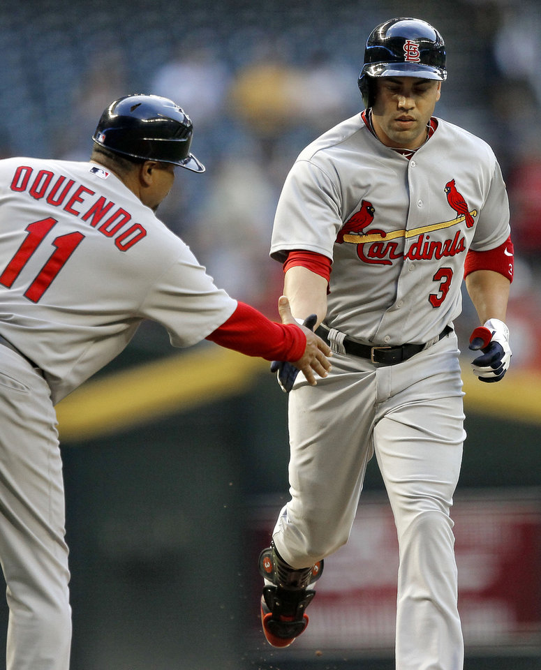 Photo -   St. Louis Cardinals' Carlos Beltran (3) is congratulated by third base coach Jose Qquendo (11) after hitting a home against the Arizona Diamondbacks during the first inning of a baseball game Tuesday, May 8, 2012, in Phoenix. (AP Photo/Matt York)