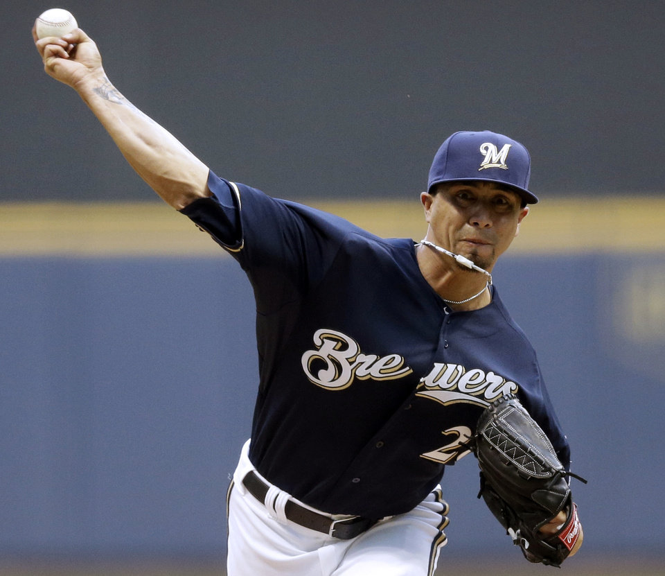 Photo - Milwaukee Brewers starting pitcher Kyle Lohse throws during the first inning of a baseball game against the Texas Rangers Wednesday, May 8, 2013, in Milwaukee. (AP Photo/Morry Gash)